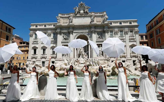 Brides wearing wedding dresses hold a flash mob near Trevi fountain to protest against the postponement of their weddings due to the coronavirus disease (COVID-19) outbreak in Rome. REUTERS