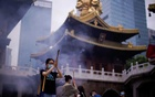 People wearing face masks worship at the Buddhist Jing'an Temple in Shanghai as it reopens following the coronavirus disease (COVID-19) outbreak, China Jul 18, 2020. REUTERS