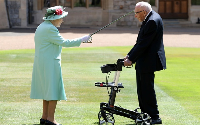 Britain's Queen Elizabeth awards Captain Tom Moore with the insignia of Knight Bachelor at Windsor Castle, in Windsor, Britain July 17, 2020. Chris Jackson/Pool via REUTERS