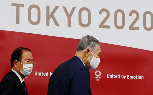 Yoshiro Mori, President of the Tokyo 2020 Olympic Games Organising Committee, and CEO Toshiro Muto wearing protective face masks leave a news conference after giving a presentation to the International Olympic Committee (IOC) about progress towards the rearranged the summer games next year, in Tokyo, Japan July 17, 2020. REUTERS