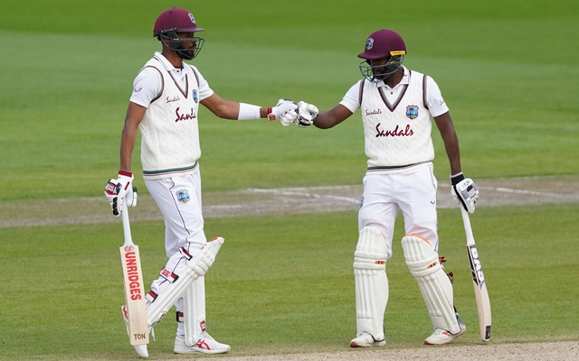 Second Test - England v West Indies - Emirates Old Trafford, Manchester, Britain - July 19, 2020 West Indies' Roston Chase and Kraigg Brathwaite, as play resumes behind closed doors following the outbreak of the coronavirus disease (COVID-19) Jon Super/Pool via REUTERS