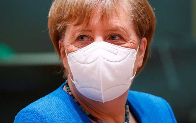 German Chancellor Angela Merkel wears a protective mask during the first face-to-face EU summit since the coronavirus disease (COVID-19) outbreak, in Brussels, Belgium July 18, 2020. REUTERS