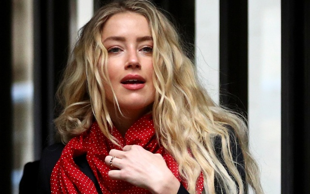 Actor Amber Heard reacts as she arrives at the High Court in London, Britain July 16, 2020. REUTERS
