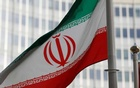 The Iranian flag flutters in front of the International Atomic Energy Agency Headquarters in Vienna, Aus. Reuters