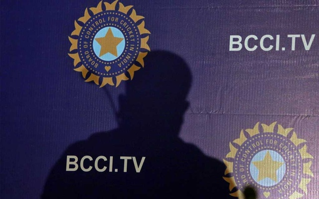 The shadow of a man falls on a backdrop with the logo of the India's cricket board BCCI before the start of a news conference to announce its cricket team's coach, in Mumbai, India, August 16, 2019. REUTERS/Francis Mascarenhas
