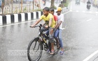 Three boys cycling amid rains in Dhaka's Agargaon on Tuesday. Photo: Asif Mahmud Ove