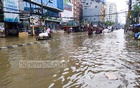 Waterlogged Green Road in Dhaka appears like a canal as it goes under water on Tuesday after incessant rains from Monday night. Photo: Asif Mahmud Ove