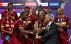 England v West Indies - World Twenty20 cricket tournament final - Kolkata, India - 03/04/2016. West Indies captain Darren Sammy (3rd L) receives the trophy from Zaheer Abbas, President of International Cricket Council (ICC), after they won the final. REUTERS