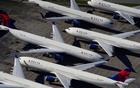 Delta Air passenger planes are seen parked due to flight reductions made to slow the spread of coronavirus disease, at Birmingham-Shuttlesworth International Airport in Birmingham, Alabama, US, on Mar 25, 2020. REUTERS
