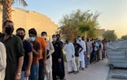 Unemployed men queue for food handouts from concerned local residents after they lost incomes due to the coronavirus disease (COVID-19) pandemic in Dubai, United Arab Emirates Jul 6, 2020. REUTERS