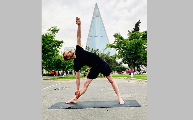 Swedish Ambassador Joachim Bergstrom practices yoga near the Ryugyong Hotel in Pyongyang on May 9, 2020. REUTERS