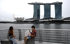 A youth takes photos at Merlion Park, amid the coronavirus disease (COVID-19) outbreak, in Singapore Jul 14, 2020. REUTERS