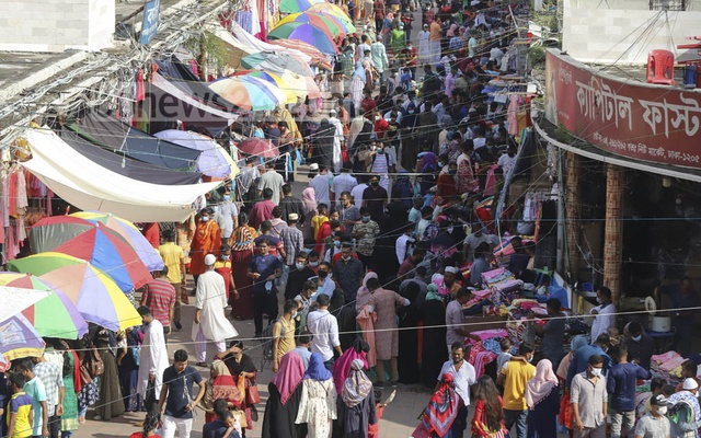 It is difficult to assume from the crowds of Eid shoppers on the walkways in Dhaka's New Market area that coronavirus cases are surging in Bangladesh. Photo: Asif Mahmud Ove