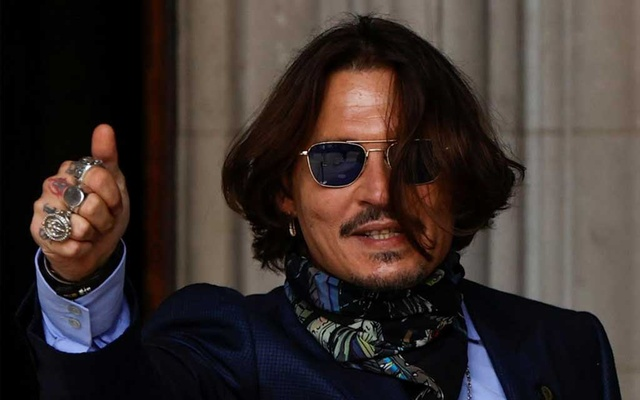 Actor Johnny Depp gestures as he arrives at the High Court in London on Jul 24, 2020. REUTERS