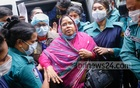 Former BCL leader Sharmin Jahan arrives in court following her arrest for supplying fake masks to health workers at Bangabandhu Sheikh Mujib Medical University Hospital amid the coronavirus crisis. Photo: Asif Mahmud Ove