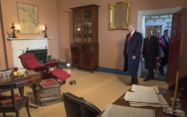 "President Donald Trump in President Andrew Jackson's study during a visit to the Hermitage, Jackson's home, in Nashville, Tenn, Mar 15, 2017. A paper titled ""Andrew Jackson in the Age of Trump,"" accusing scholars of ""historical malpractice,"" upended an academic society and stirred arguments about racism, history and the limits of debate. Stephen Crowley/The New York Times"