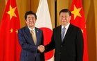 Chinese President Xi Jinping and Japanese Prime Minister Shinzo Abe shake hands at the start of talks at a hotel, prior to the G20 Summit at the International Exhibition Center in Osaka, western Japan, June 27, 2019. Kimimasa Mayama/Pool via REUTERS