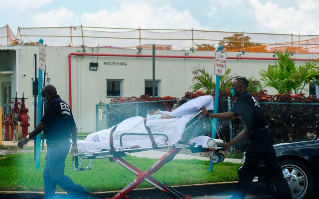 Emergency Medical Technicians (EMT) leave with a patient at North Shore Medical Centre where the coronavirus disease (COVID-19) patients are treated, in Miami. REUTERS