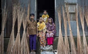 Monwara Begum, centre, with her children at her house near Dhaka, Bangladesh, July 19, 2020. As the pandemic destroys paychecks, migrant workers like Begum's husband, Mahammed Heron, are sending less money home, threatening an increase in poverty from South Asia and sub-Saharan Africa to Eastern Europe and Latin America. (Salahuddin Ahmed/The New York Times)