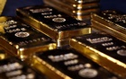 Gold rockets toward $2,000 as Fed stimulus sinks dollar