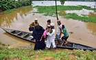 Flood-affected villagers disembark a boat after they reached a safer place at Kachua village in Nagaon district, in the northeastern state of Assam, India, Jul 22, 2020. REUTERS/FILE