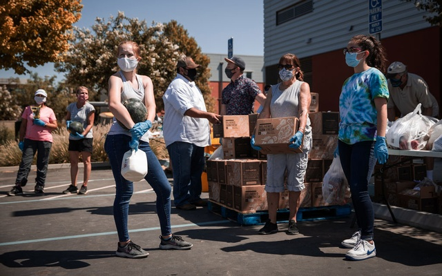 Volunteers at a food bank in Davis, Calif., handed out groceries on July 23, 2020. Food insecurity, as defined by the government, includes not only people who lack food but also those whose diets suffer from poor quality or whose access to food is so uncertain it causes them to worry. (Max Whittaker/The New York Times)