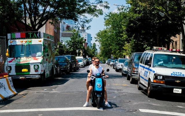 A man and woman ride on a Revel moped in Brooklyn on Jul 28, 2019. The moped-sharing company announced on Tuesday, July 28, 2020, that it is suspending its operations in New York City following the second fatality involving Revel vehicles in two weeks. Lucia Buricelli/The New York Times
