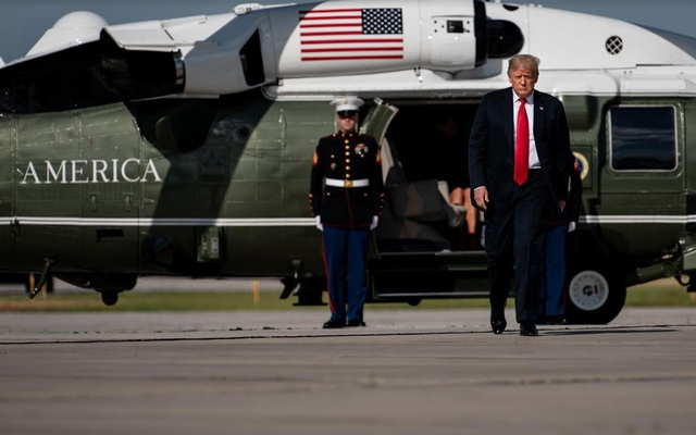 President Donald Trump walks from Marine One to board Air Force One in Green Bay, Wis., June 25, 2020. Trump will not try again to immediately terminate President Barack Obama's program that protects young undocumented immigrants, after the Supreme Court's decision to invalidate Trump's first attempt make good on a crackdown that is at the core of his political identity. (Erin Schaff/The New York Times)