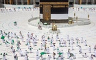 Muslim pilgrims maintain social distancing as they pray while others circle the Kaaba at the Grand mosque during the annual Haj pilgrimage amid the coronavirus disease (COVID-19) pandemic, in the holy city of Mecca, Saudi Arabia July 29, 2020. Saudi Ministry of Media/Handout via REUTERS