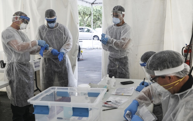 Healthcare workers at a testing site for the coronavirus, in Orlando, Fla., on Tuesday, July 28, 2020. Declassified US intelligence accuses Moscow of pushing propaganda through alternative websites as Russia refines techniques used in 2016. (Eve Edelheit/The New York Times)