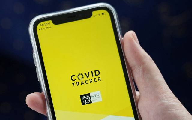 The COVID Tracker Ireland app used for contact tracing the spread of coronavirus disease (COVID-19) is displayed on a mobile phone, as it is held up for an illustration photograph in Galway, Ireland, July 30, 2020. REUTERS