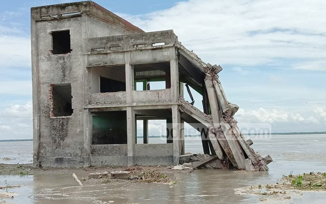Another building of Basaker Char Government Primary School in Shariatpur is at risk of being devoured by the Padma River amid flooding. A single-storey unit of the school was lost to the river on Wednesday.