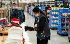 A worker is seen wearing a mask while organising merchandise at a Walmart store, in North Brunswick, New Jersey, US July 20, 2020. REUTERS