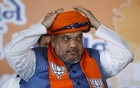 India's ruling Bharatiya Janata Party (BJP) president Amit Shah adjusts a turban presented by his supporters during BJP workers meeting in Gandhinagar, in the western state of Gujarat, India, February 27, 2016. Reuters