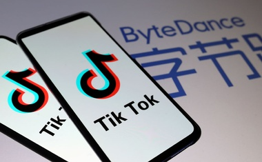TikTok logos are seen on smartphones in front of a displayed ByteDance logo in this illustration taken November 27, 2019. REUTERS