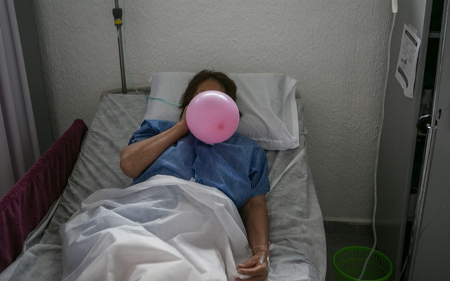 A patient uses a balloon to strengthen her lungs as she recovers from the coronavirus at a makeshift hospital in Mexico City, Jun 30, 2020. Lockdowns and supply-chain disruptions amid the coronavirus pandemic threaten progress against tuberculosis as well as HIV and malaria. Meghan Dhaliwal/The New York Times