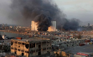 Smoke rises from the site of an explosion in Beirut's port area, Lebanon Aug 4, 2020. REUTERS