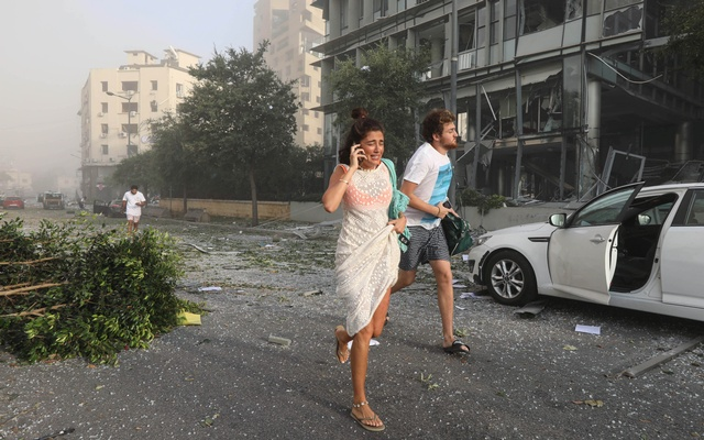 People run for cover following an explosion in Beirut's port area, Lebanon August 4, 2020. Reuters