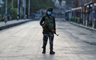 An Indian Central Reserve Police Force (CRPF) officer patrols on an empty street during a lockdown on the first anniversary of the revocation of Kashmir's autonomy, in Srinagar Aug 5, 2020. REUTERS