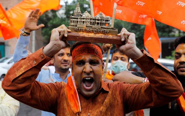 A supporter of ruling Bharatiya Janata Party (BJP) holds a model of proposed Ram Temple in Ayodhya as they celebrate the stone laying ceremony, in New Delhi, India August 5, 2020. REUTERS