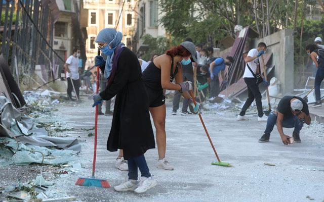 Volunteers clean the streets following Tuesday's blast in Beirut's port area, Lebanon, Aug 5, 2020. REUTERS
