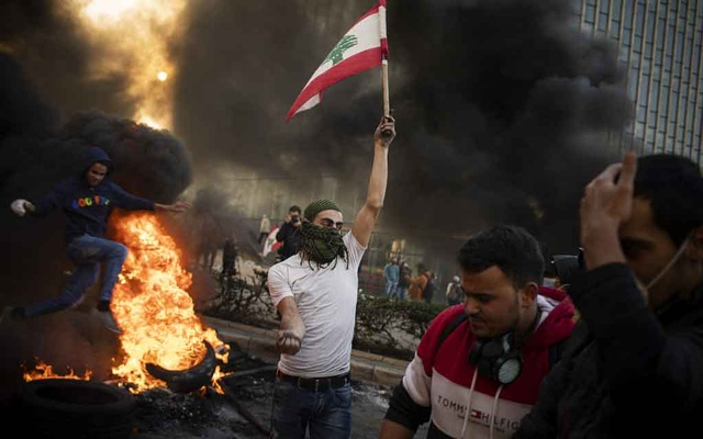 FILE -- Protesters in Beirut, Jan 14. 2020. As residents picked up the pieces, many saw the recent explosion at the port of Beirut as the culmination of years of mismanagement and neglect by Lebanon's political leaders. (Diego Ibarra Sanchez/The New York Times)