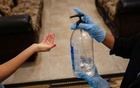 A funeral attendant provides hand sanitiser to a mourner arriving for a visitation in Elsa, Texas, Jul 21, 2020. Federal health authorities issued a formal warning on Wednesday, Aug 5, about the dangers of drinking hand sanitiser and alerted poison control centres across the nation to be on the lookout for cases of methanol toxicity after four people died and nearly a dozen became ill. Tamir Kalifa/The New York Times