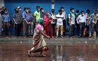 Passengers wearing masks wait in a queue to board a bus, after authorities eased lockdown restrictions that were imposed to slow the spread of the coronavirus disease (COVID-19), in Kolkata, India, Aug 6, 2020. REUTERS