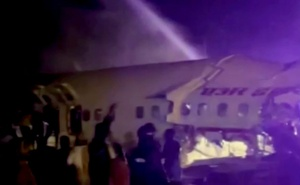 A passenger plane that crashed after it overshot the runway is seen at Calicut International Airport in Karipur, southern state of Kerala, India, August 7, 2020, in this still image obtained from a video. ANI/Reuters TV/via REUTERS