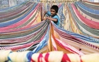 A boy separates starched sarees, a traditional Indian garment for women in the southern Indian city of Hyderabad November 30, 2012. REUTERS