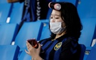 A fan wearing a protective face mask in the stands, as the match resumes with fans for the first time since the outbreak of coronavirus disease (COVID-19). REUTERS
