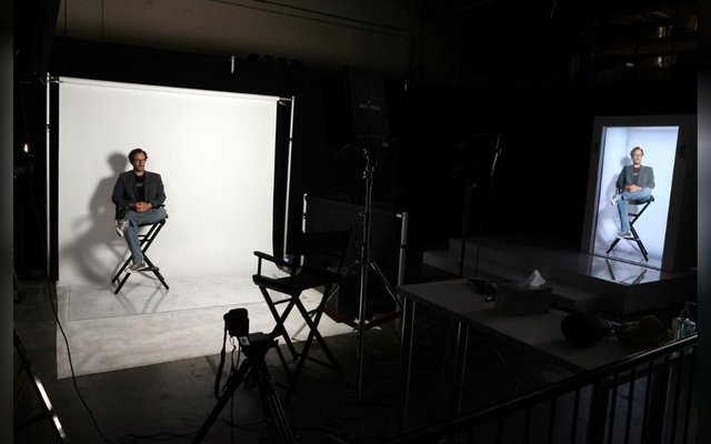 Portl inventor David Nussbaum is shown with an AI-powered life-size hologram of himself in Gardena, near Los Angeles, California, US, Aug 3, 2020. REUTERS