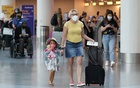 Passengers wear masks as they walk through LAX airport, as the global outbreak of the coronavirus disease (COVID-19) continues, in Los Angeles, California, US, Aug 4, 2020. REUTERS