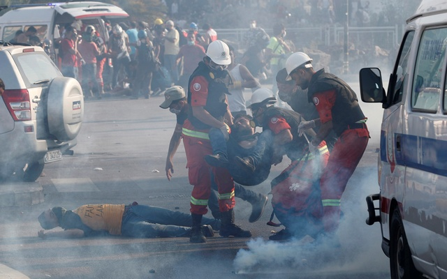 Rescuers assist demonstrators during a protest, following Tuesday's blast, in Beirut, Lebanon August 8, 2020. Reuters